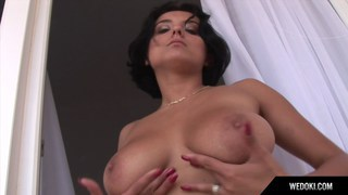 Busty babe masturbates on balcony