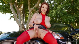 Hot girl Eva Notty is posing on a car