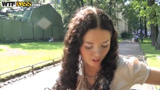 Cute curly brunette Leonora shows her boobs in park