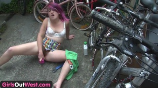 Girls Out West - Horny bicyclist toys her hairy cunt