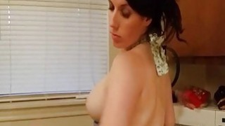 Naughty housewife bangs her cunt with a dildo on kitchen table