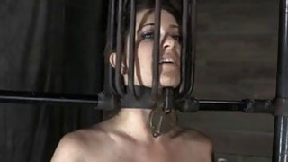 Restrained girl is hoisted up for her castigation