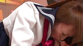 Aroused Asian schoolgirl sucking on the teachers h