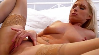 Beautiful MILF masturbating in stockings