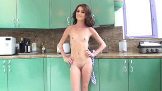 Renee Roulette strips and poses, flirtatiously flaunting her holes