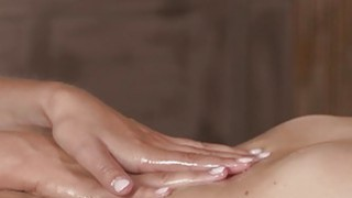 Blonde lesbo masseuse shoves finger into brunette