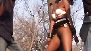 African female tied to a tree flogged and fucked hard