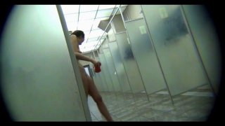 Female intimacy in  public shower room